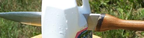 A scramasax dagger piercing a water filled jug